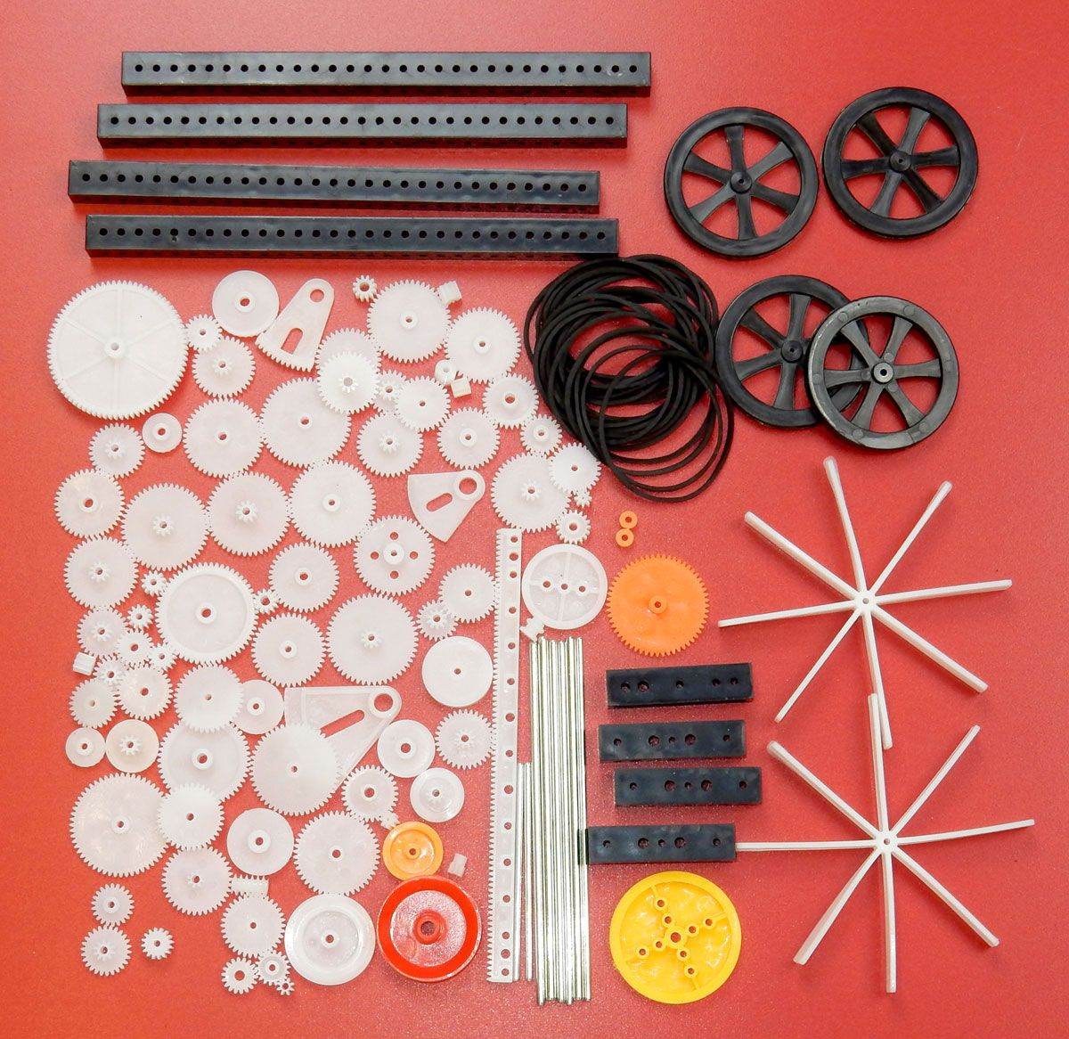 92 PIECE ASSORTMENT OF GEARS, PULLEYS, AXLES ETC.
